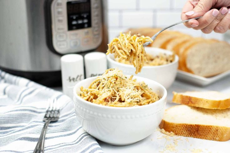 pasta carbonara in white bowl