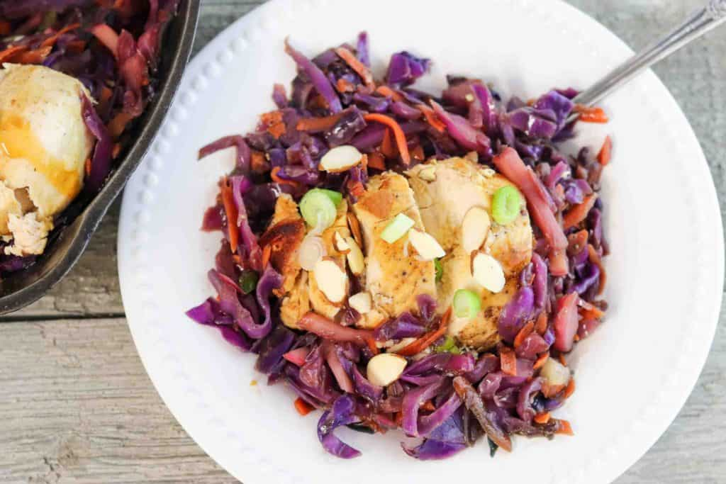 chicken with cabbage stir fry on white plate