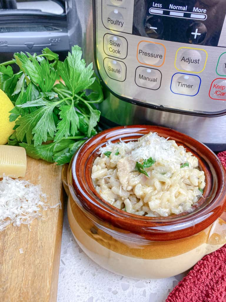 risotto in brown crock bowl