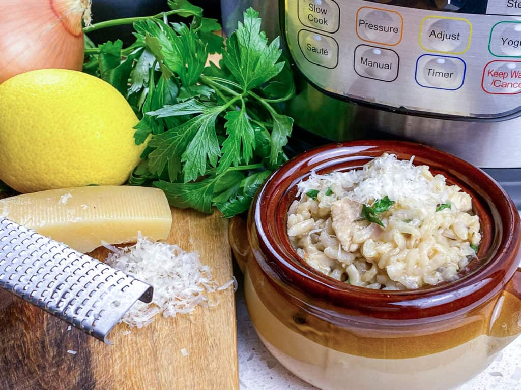 instant pot risotto with parmesan cheese in bowl