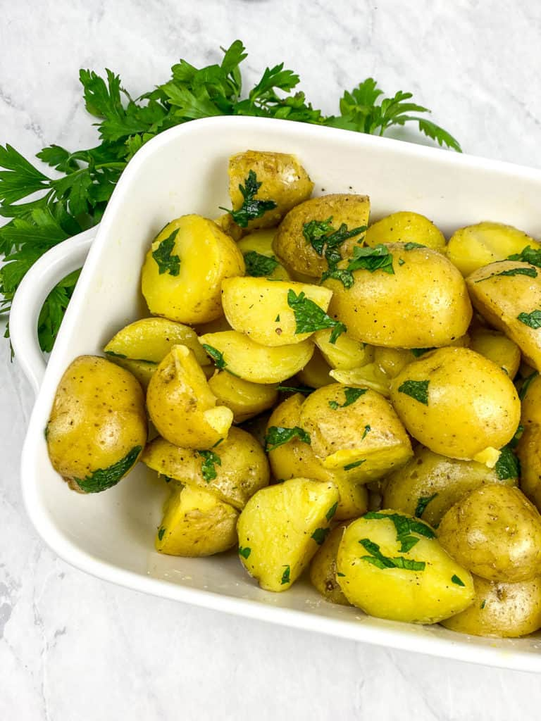 butter potatoes in white dish