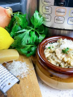 parmesan risotto in brown bowl