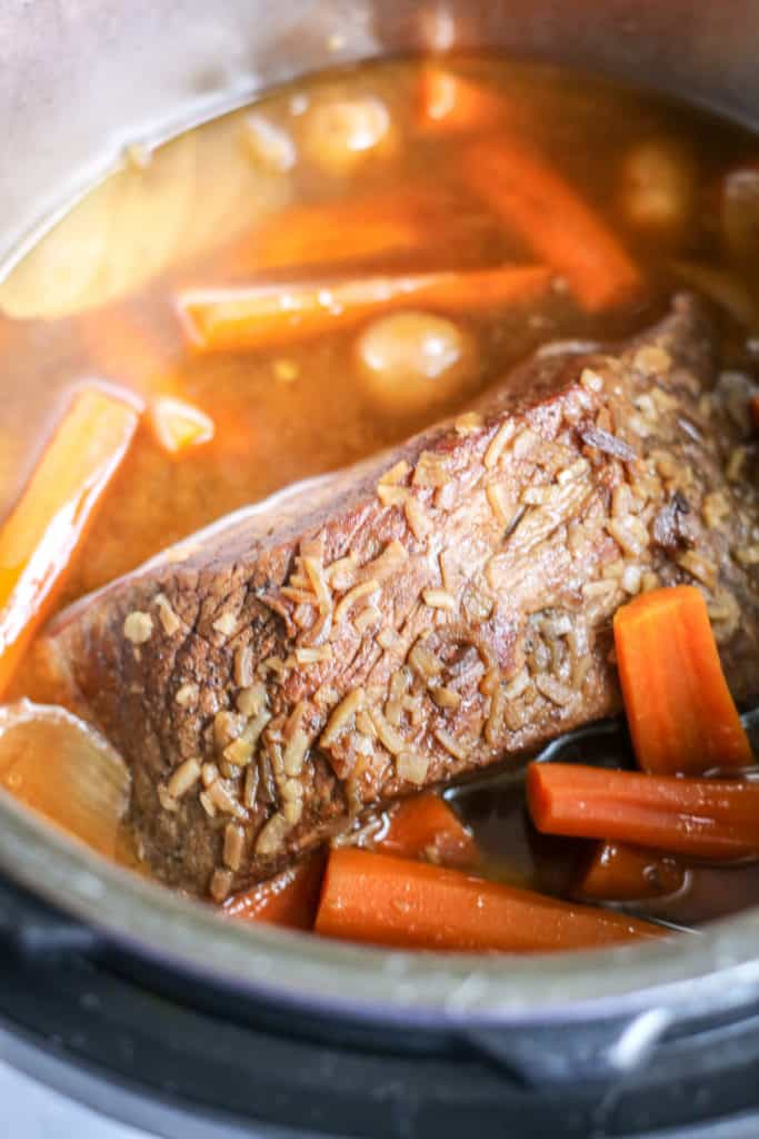 instant pot pot roast in the pot with carrots