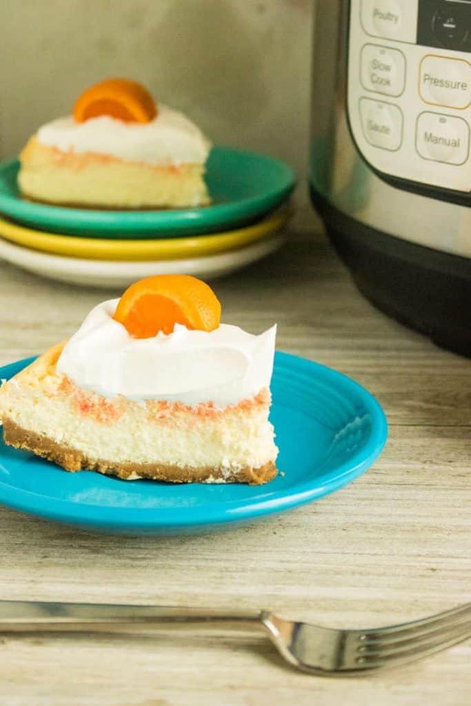 orange cheesecake on blue plate