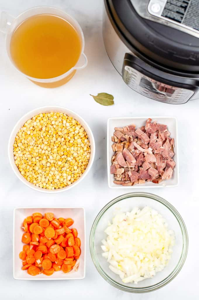 ingredients for split pea soup measured out in ingredient bowls on counter