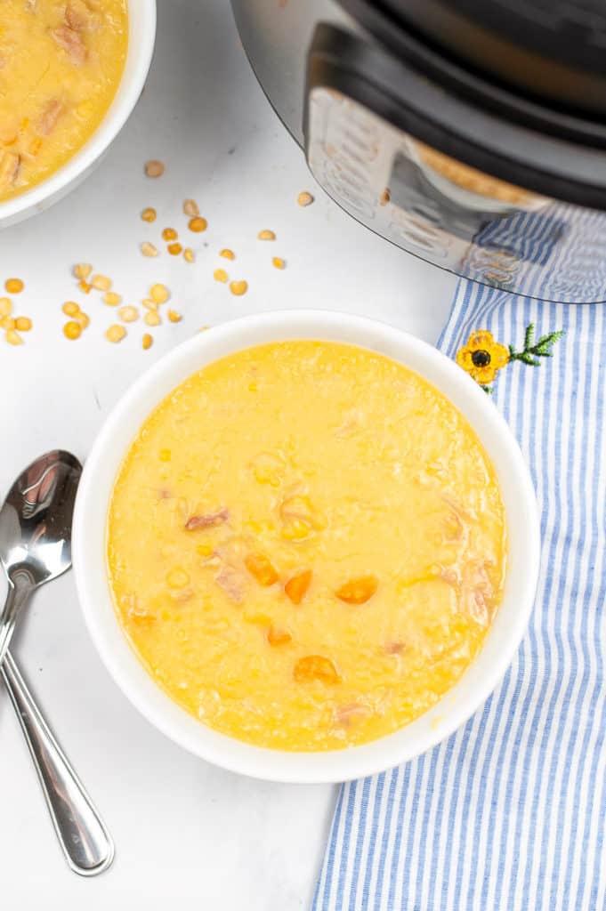 yellow split pea soup in white bowl