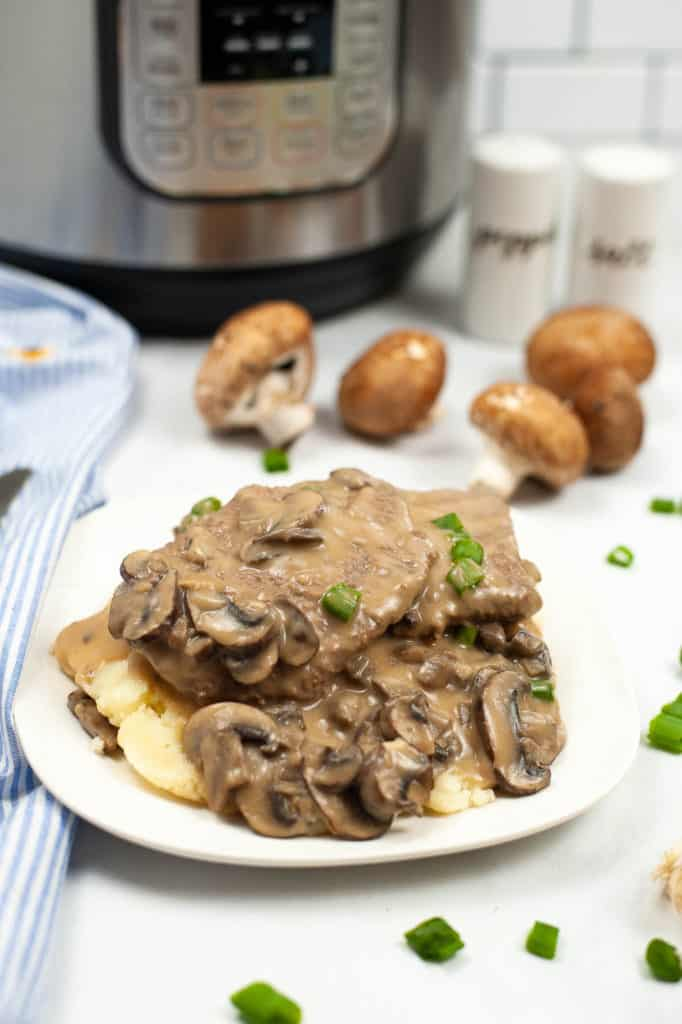 Mushroom steak on white plate