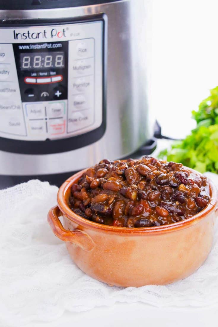 chili in a bowl in front of an Instant Pot