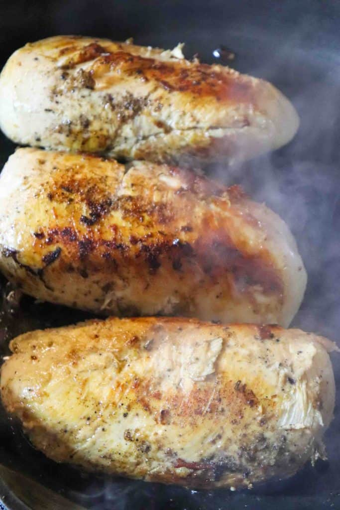 chicken breast pan searing in cast iron pan