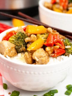 cashew chicken with vegetables in white bowl