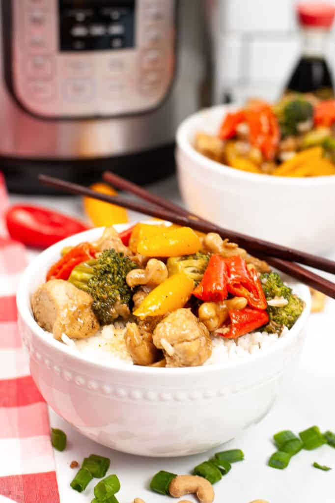 cashew chicken in white bowl