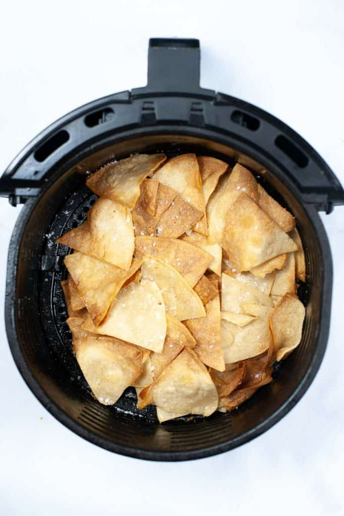 cooked tortilla chips in air fryer basket
