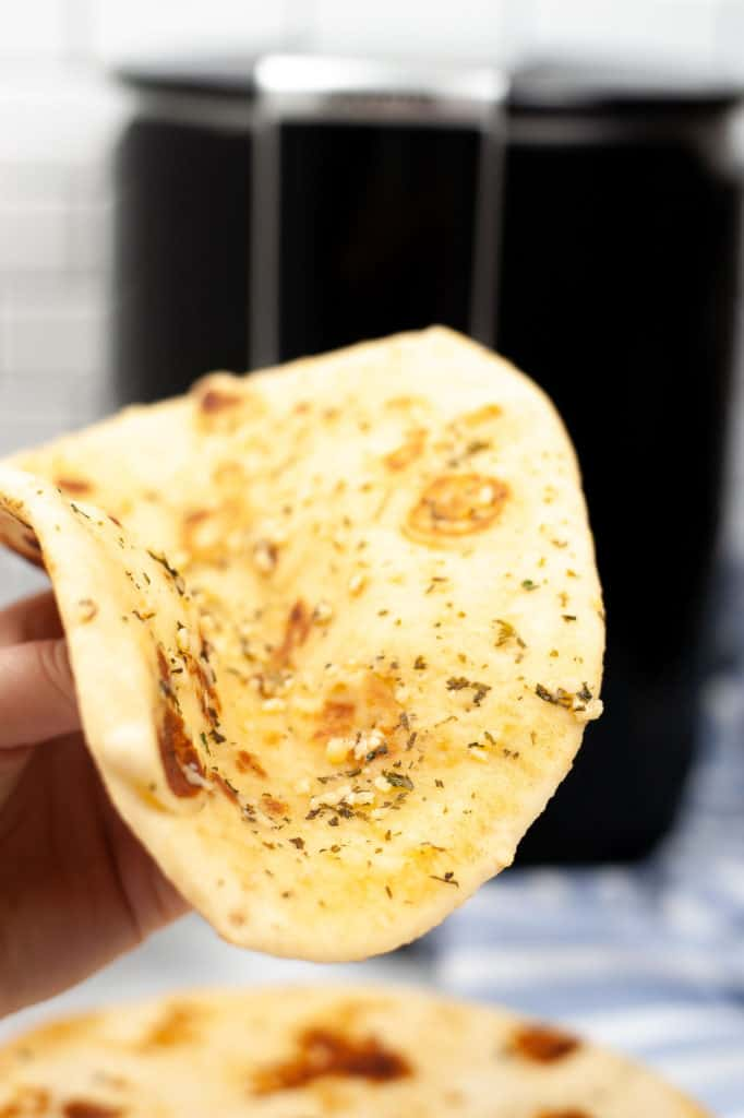 hand holding air fryer naan bread