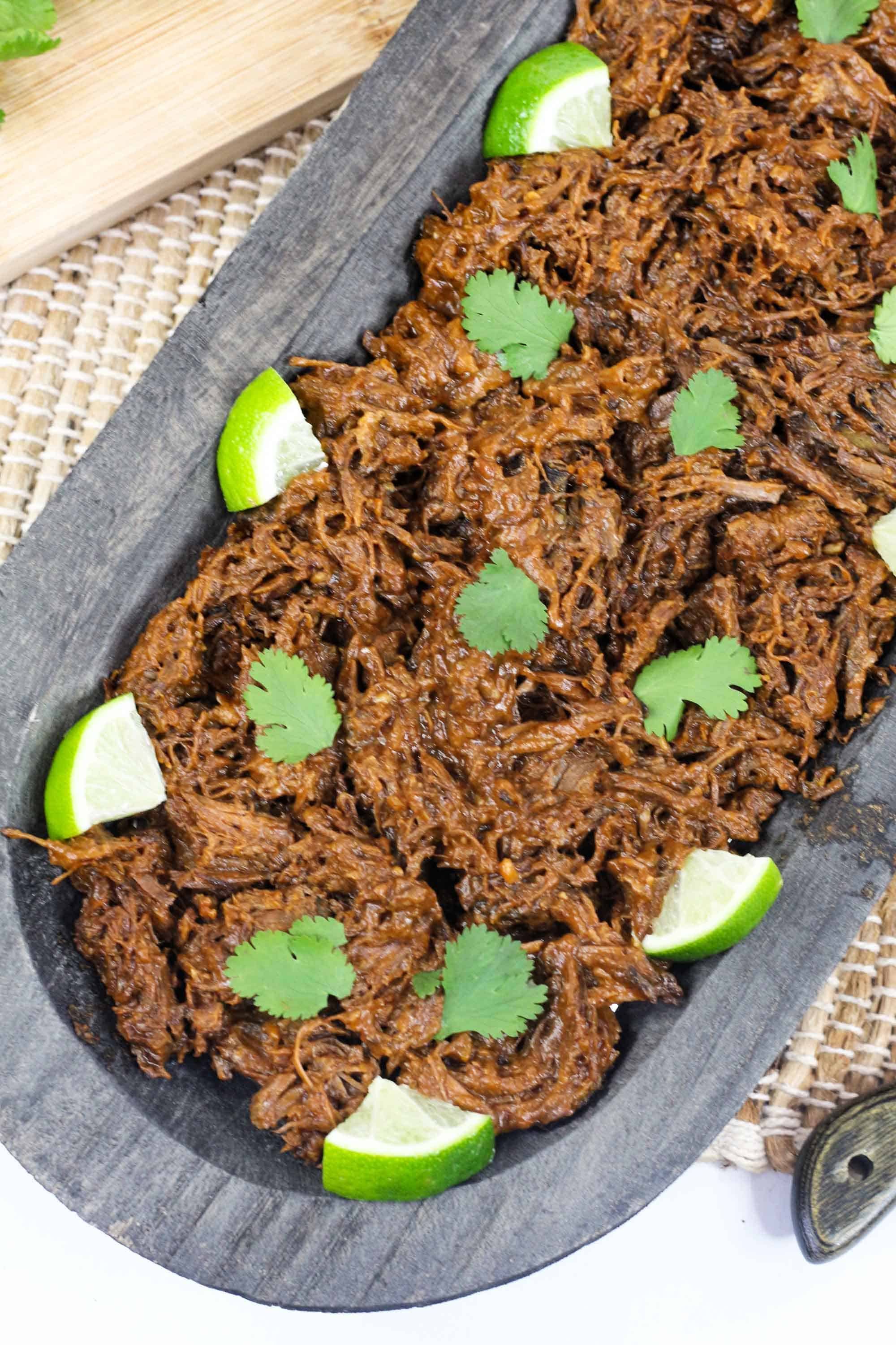 instant pot barbacoa recipe for beef for tacos on serving tray