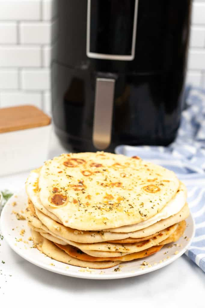 air fryer naan bread on white plate