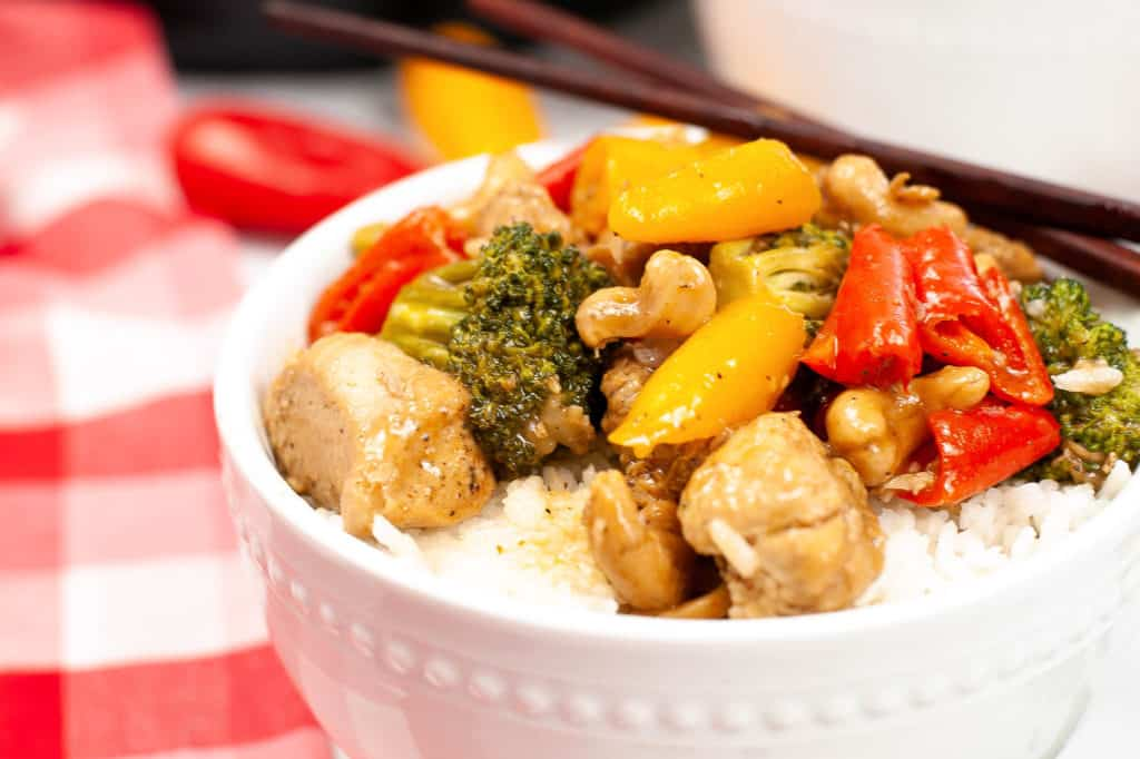 chicken cashew with vegetables in  bowl with rice