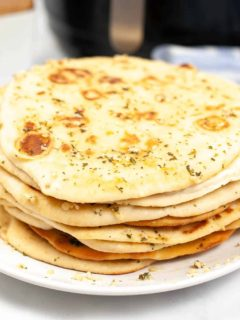 air fryer naan on white plate