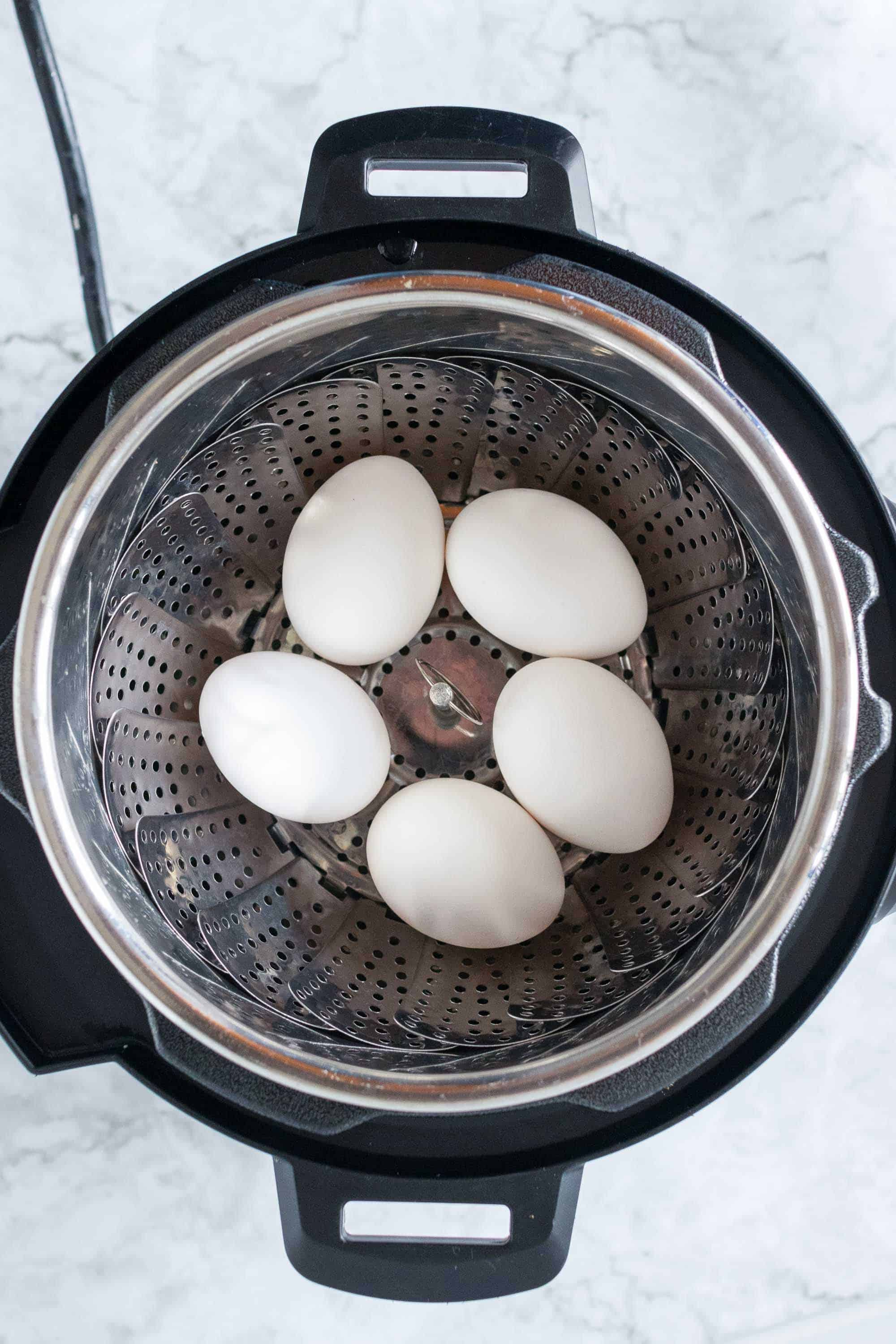 steamer basket in instant pot with eggs in it