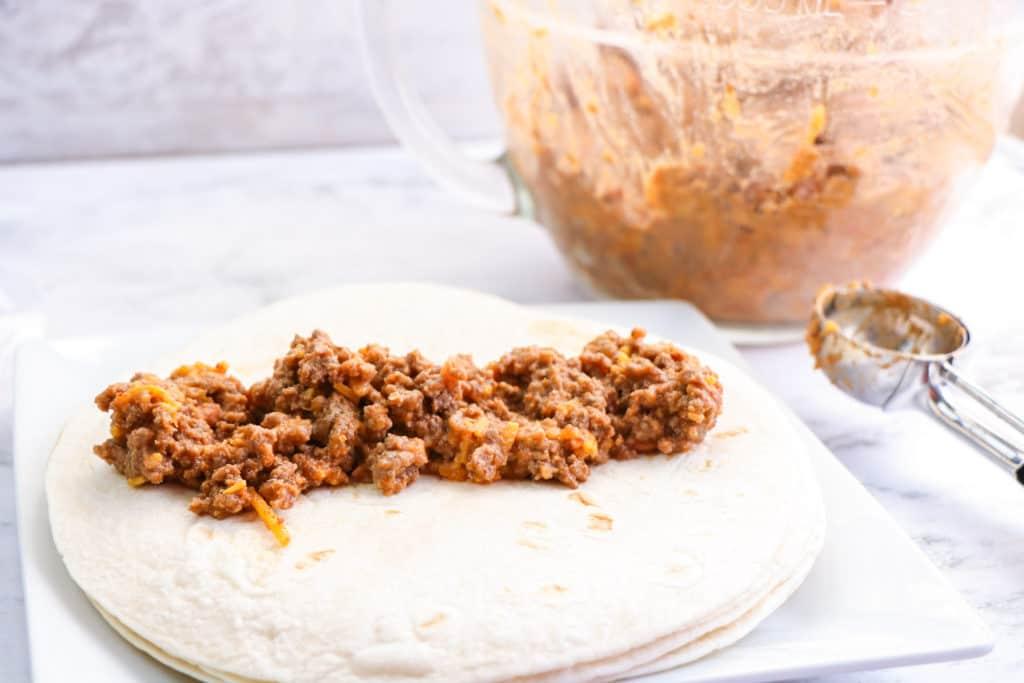 taquito filling spread on tortilla