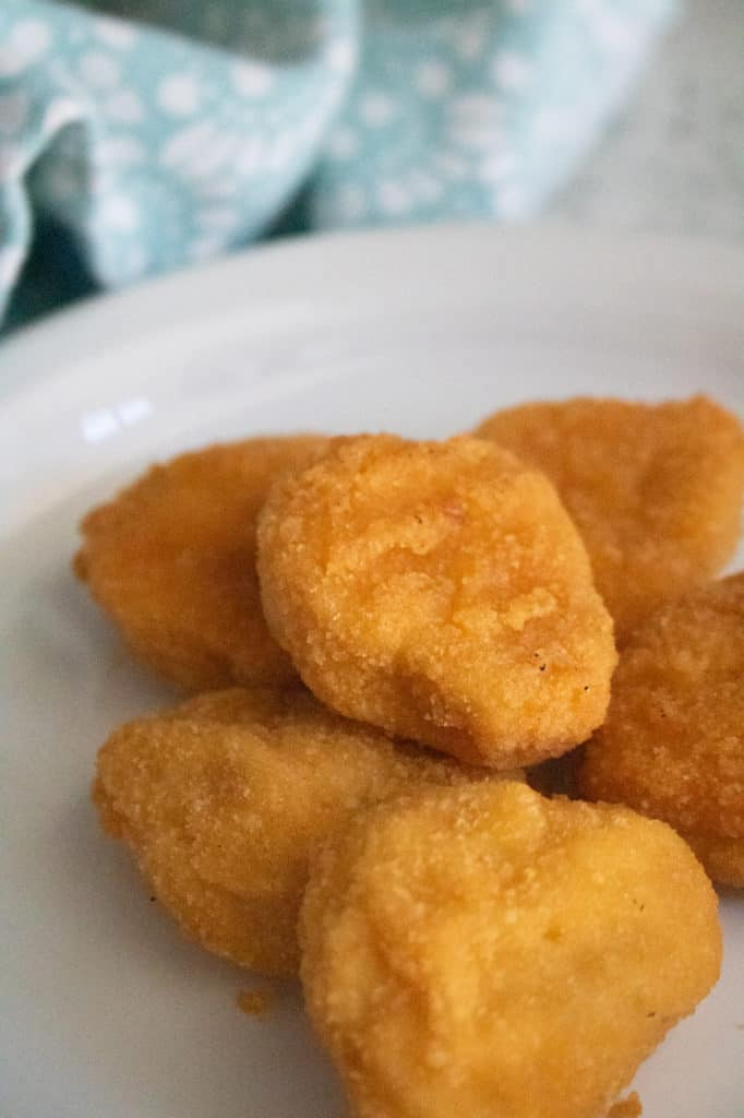 chicken nuggets on white plate